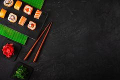 Set of sushi and maki on stone table. Top view with copy space.  stock photos