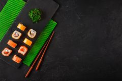 Set of sushi and maki on stone table. Top view with copy space.  stock images