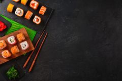 Set of sushi and maki on stone table. Top view with copy space stock photos
