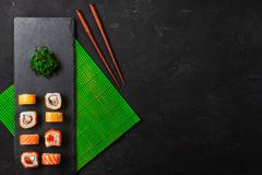 Set of sushi and maki on stone table. Top view with copy space.  stock photo