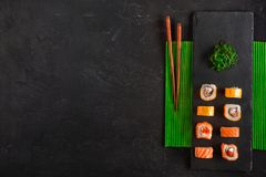 Set of sushi and maki on stone table. Top view with copy space.  royalty free stock photography