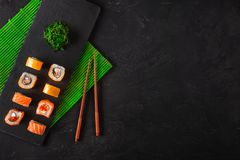 Set of sushi and maki on stone table. Top view with copy space.  royalty free stock image