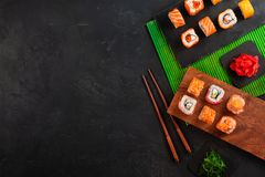 Set of sushi and maki on stone table. Top view with copy space.  stock photography