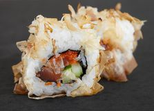 Set of sushi roll, fish delicacy close-up. On a dark background Royalty Free Stock Photos