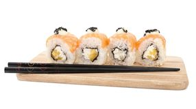 Set of sushi roll on a wooden plate, isolated on white. Close-up royalty free stock photo