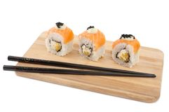 Set of sushi roll on a wooden plate, isolated on white. Close-up stock photos