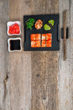 Set of sushi and rolls with chopsticks on wooden table Royalty Free Stock Images