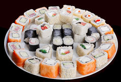 Set of sushi rolls. Delicious set of sushi rolls agains black background. Japanese cuisine Royalty Free Stock Photography