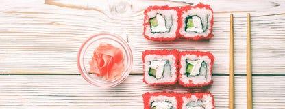 Set of sushi rolls of fresh shrimps cucumber avocado Tobiko caviar and Philadelphia stock photos