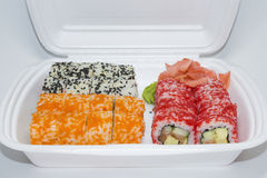 Set of sushi rolls in a plastic box Stock Photo
