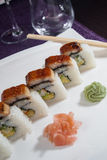 Set of sushi rolls with wasabi and ginger. On white plate Royalty Free Stock Images
