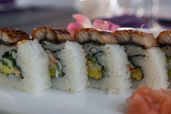 Set of sushi rolls. On white plate Stock Images