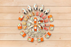Set of sushi and rolls at wood. Royalty Free Stock Image