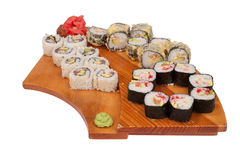 Set of sushi rolls on wood stand Stock Photography