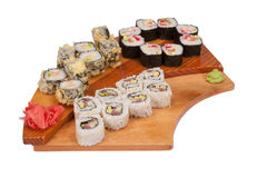 Set of sushi rolls on wood stand Royalty Free Stock Photography