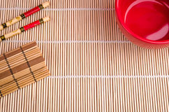 Set for sushi the top view with copy space. Red cup, chopsticks and a bamboo napkin the top view with copy space Stock Photo