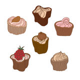Set of sweet bakery decorated cupcakes hand drawn in vintage style. Vector illustration. Isolated on white background. Set of sweet bakery decorated cupcakes Royalty Free Stock Photography
