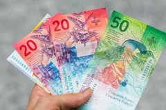 Set of swiss franc banknotes isolated on grey background stock photos