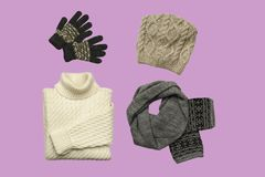 Set of sylish winter clothes on colour background with hat, mittens, sweater, scarf. flat lay, top view. Hat, mittens, sweater, scarf isolated on colour royalty free stock image