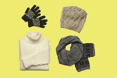 Set of sylish winter clothes on colour background with hat, mittens, sweater, scarf. flat lay, top view. Hat, mittens, sweater, scarf isolated on colour royalty free stock photography