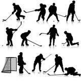 Set sylwetki gracz w hokeja Odizolowywający dalej Obrazy Stock