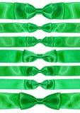 Set of symmetric bow knots on green satin ribbons Stock Photo