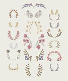 Set of symmetrical floral graphic design elements. Stock Photo