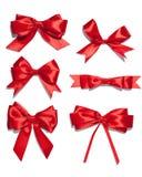 Set sześć czerwień atłasu tasiemkowych łęków Fotografia Stock