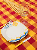 Set table. A nicely set table at home with colorful table cloth Royalty Free Stock Images