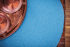 Set of table cloth coppery tray and tea cups Stock Photography