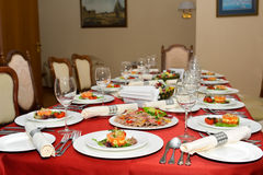 Set table in the dining room. Designed luxury house Royalty Free Stock Photography