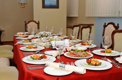 Set table in the dining room. Designed luxury house Royalty Free Stock Photos