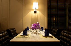 The set of table for dinner with leather chair Stock Photos