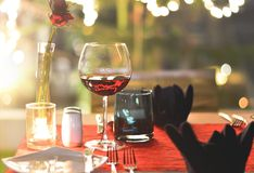 Set the table for dinner with wine romantic style. Set the table for dinner with wine and romantic style Royalty Free Stock Images