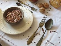 Set table with a plate of beans and antique tableware Royalty Free Stock Photography