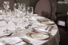 Set table with white linen. In a fancy restaurant Royalty Free Stock Image