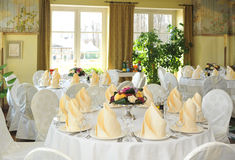 Set tables in the dining room. Set table in the dining hall Stock Image