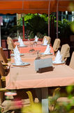 Set tables at outside dining area Royalty Free Stock Photography