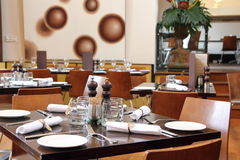 Set tables in restaurant. A tastefully decorated restaurant with well-laid tables, all tone-in-tone Royalty Free Stock Photos