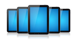 Set Of Tablet Computers Isolated. Set of digital tablets with blank blue screen isolated on white Stock Images