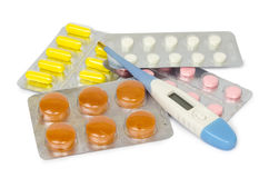 A set of tablets and pills for a speedy recovery and prevention of diseases. Isolated Stock Photo