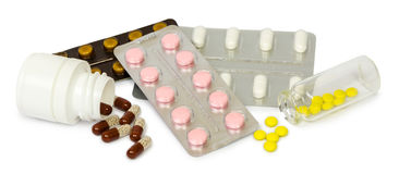 A set of tablets and pills for a speedy recovery and prevention of diseases. Isolated Stock Photography