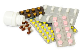 A set of tablets and pills for a speedy recovery and prevention of diseases. Isolated Royalty Free Stock Image