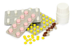 A set of tablets and pills for a speedy recovery and prevention of diseases. Isolated Royalty Free Stock Photos