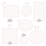 Set of tags with hand drawn easter bunny head and easter eggs. Stock Photo