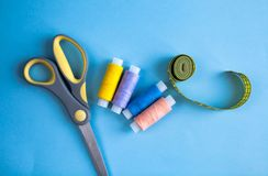 Set of tailoring accessories on light background, top view royalty free stock photos