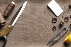 Set of tailoring tools and accessories on fabric royalty free stock photo