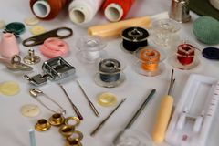 Set of tailoring tools and accessories on table. Closeup Stock Images