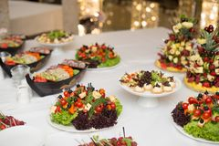 Set of tasty canape, on a plate of greens, tomatoes, peppers, cheese. Stock Image