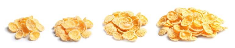 Set with tasty crunchy corn flakes. On white background stock photos